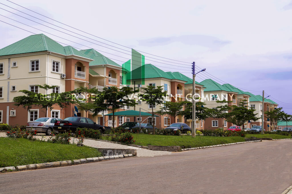 Apartment buildings in abuja with cars parking lot