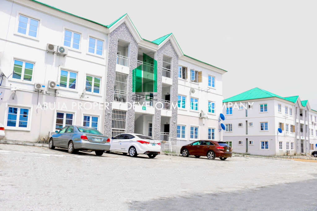3 bedroom building APDC phase 1 estate Abuja with cars in garage