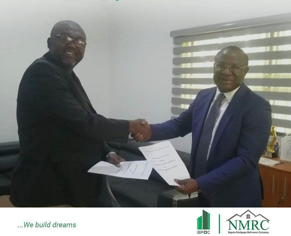 former APDC MD sand NMRC boss shaking hands in an office