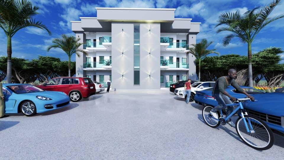 Cars parked and man riding a bicycle in front of APDC studio apartment
